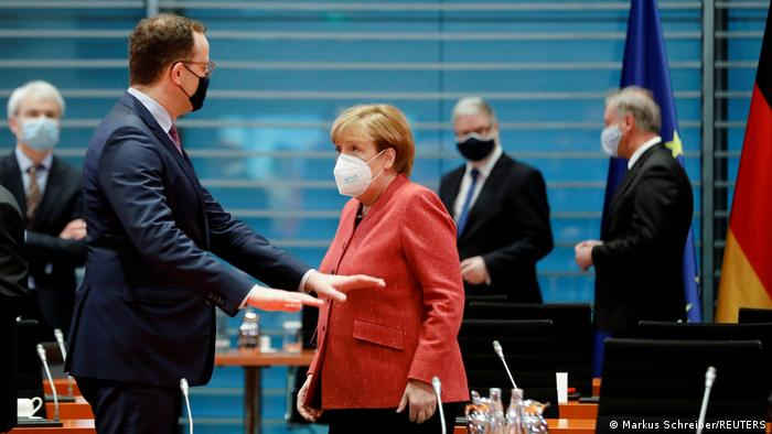 Angela Merkel with Jens Spahn at a cabinet meeting