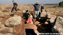 Israel Antiquities Authority (IAA) archeologists work at a fortified complex from the time of King David which was exposed for the first time in archaeological excavations carried out by IAA in the Hispin settlement in the Israeli-annexed Golan Heights on November 11, 2020. - Israeli archaeologists unveiled Wednesday a fortified structure in the Israeli-occupied Golan Heights from the time of King David, which sheds light on the borders and size of an ancient kingdom. The 3000-year-old fort, found near the southern Golan community Hispin ahead of works to build a new neighbourhood, is believed to have belonged to the Geshurites, allies of the Israelite king. (Photo by MENAHEM KAHANA / AFP)