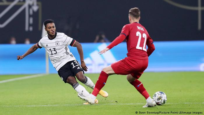 Ridle Baku in action on his international debut for Germany against the Czech Republic