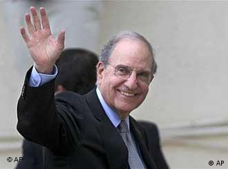 U.S. Middle East envoy George Mitchell waves to the press before his meeting with Palestinian President Mahmoud Abbas, not pictured, in the West Bank city of Ramallah, Saturday, May 8, 2010. Palestinian leaders on Saturday gave their backing for indirect peace talks with Israel, clearing the way for the Obama administration's first sustained on-the-ground Mideast peace effort. U.S. envoy George Mitchell will now shuttle between the Israeli and Palestinian leaders for up to four months to try to narrow the vast gaps on the terms of Palestinian statehood. (AP Photo/Majdi Mohammed