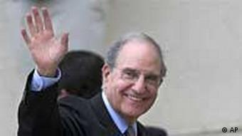 U.S. Middle East envoy George Mitchell waves to the press before his meeting with Palestinian President Mahmoud Abbas, not pictured, in the West Bank city of Ramallah, Saturday, May 8, 2010. Palestinian leaders on Saturday gave their backing for indirect peace talks with Israel, clearing the way for the Obama administration's first sustained on-the-ground Mideast peace effort. U.S. envoy George Mitchell will now shuttle between the Israeli and Palestinian leaders for up to four months to try to narrow the vast gaps on the terms of Palestinian statehood. (AP Photo/Majdi Mohammed)