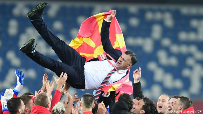 North Macedonia coach Igor Angelovski is held aloft after the team's qualification for Euro 2020 was confirmed