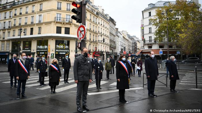 Paris Mayor Anne Hidalgo and French Prime Minister Jean Castex pay tribute outside La Bonne Biere cafe bar in Paris, France