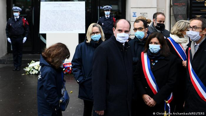 Paris Mayor Anne Hidalgo, French Prime Minister Jean Castex and Mayor of Paris' 11th arrondissement Francois Vauglin pay tribute outside the Bataclan concert venue (Christophe Archambault/REUTERS)