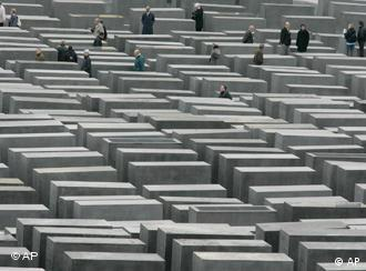 Visitors wander through the Berlin Holocaust Memorial