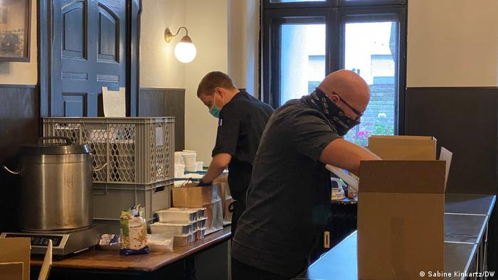 Restaurant staff packing boxes