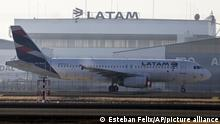A Latam airplane sits parked at the Arturo Merino Benitez airport in Santiago, Chile, Tuesday, May 26, 2020. South America's biggest carrier is seeking U.S. bankruptcy protection as it grapples with a sharp downturn in air travel sparked by the coronavirus pandemic. (AP Photo/Esteban Felix) |