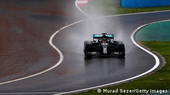 Lewis Hamilton driving in the wet