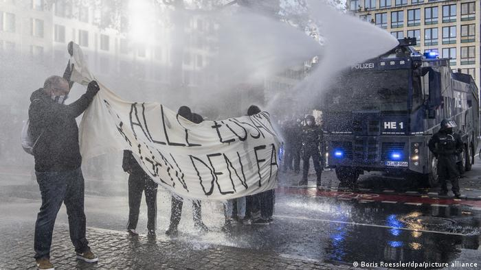 Police using water cannons in Frankfurt