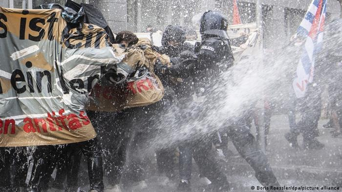 Police clash with counterprotesters