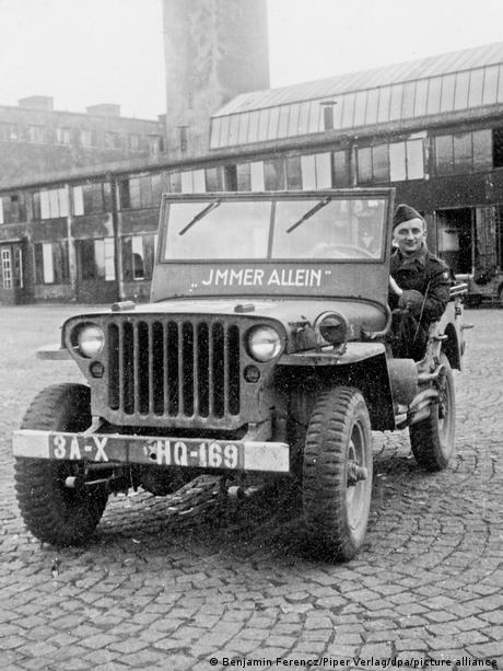 Ferencz in a US Army jeep on a cobblestone street in Germany | Ben Ferencz