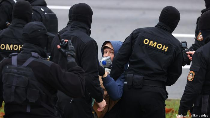 Anti-riot police officers in Belarus detain a protester in Belarus