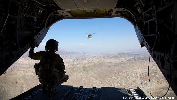 US 101st Airbone flying over Afghan mountains