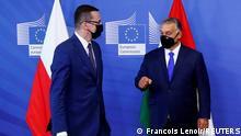 FILE PHOTO: Poland's Prime Minister Mateusz Morawiecki and Hungary's Prime Minister Viktor Orban arrive ahead of a meeting with European Commission President Ursula von der Leyen in Brussels, Belgium September 24, 2020 REUTERS/Francois Lenoir/Pool/File Photo