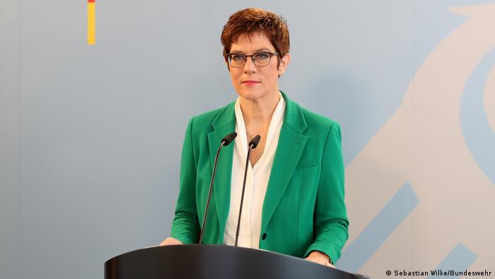 Annegret Kramp-Karrenbauer standing at the microphones
