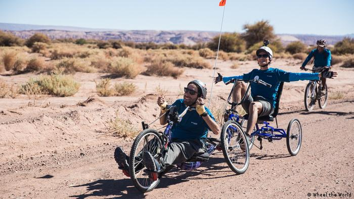 Three cyclists in a desert in Chile