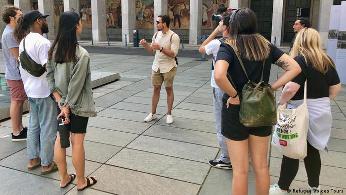 A group of tourists listening to their guide in Berlin, Germany