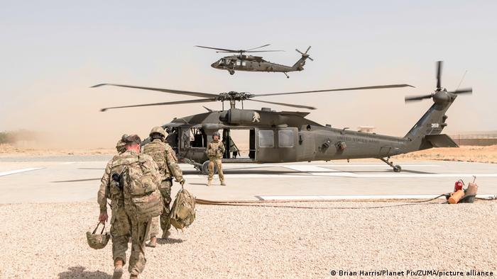 US soldiers heading towards a helicopter in Kunduz, Afghanistan