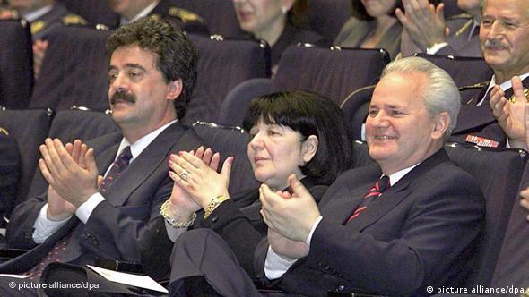 Slobodan Milosevic (r), his wife Mirjana Markovic and Yugoslavian Prime Minister Momir Bulatovic in 1999
