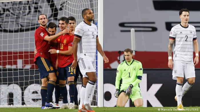 Jonathan Tah, Manuel Neuer and Robin Koch look dejected after Spain score their fourth goal in Sevilla in November