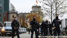 18.11.2020 Police officers stand guard during a protest against the government's coronavirus disease (COVID-19) restrictions, near the Reichstag, the seat of Germany's lower house of parliament Bundestag, in Berlin, November, 18, 2020. REUTERS/Christian Mang