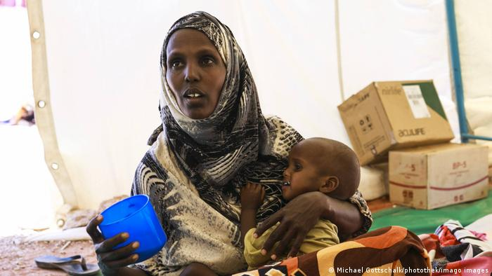 An Ethiopian refugee mother and her young child at a refugee camp in Sudan