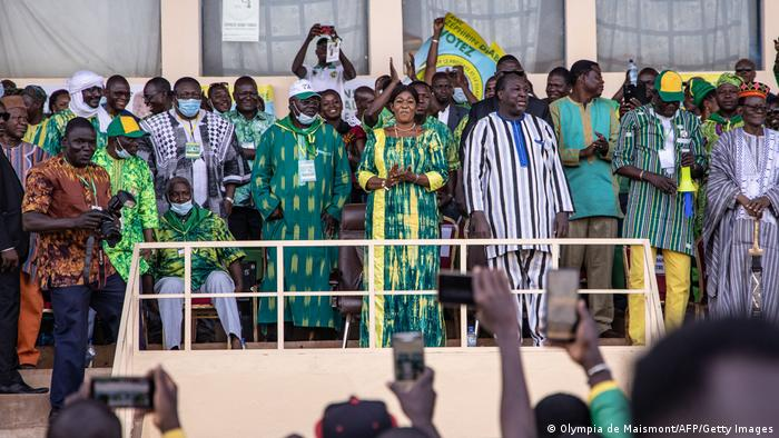 Presidential candidate Zephirin Diabre stands on a podium and waves at the crowd
