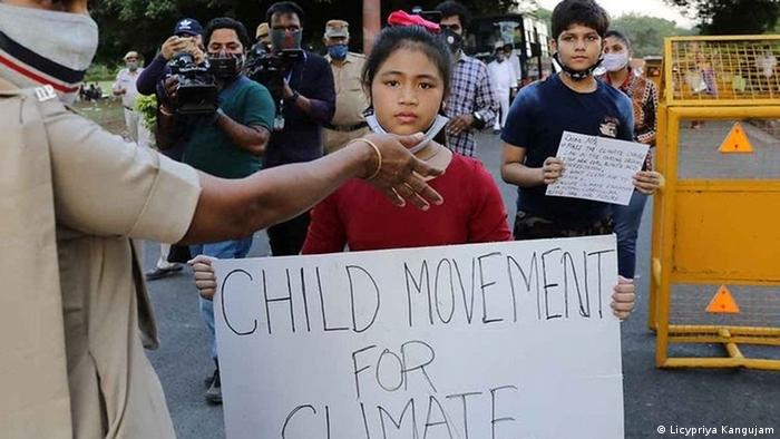 Licypriya Kangujam with a sign that reads 'Child Movement for Change'