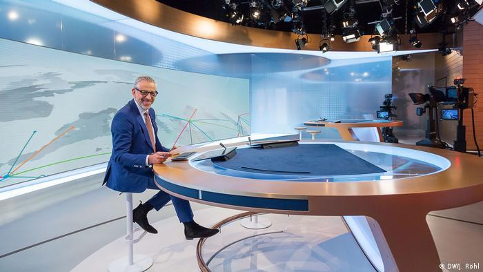 The DW News studio in Berlin with presenter Gerhard Elfers