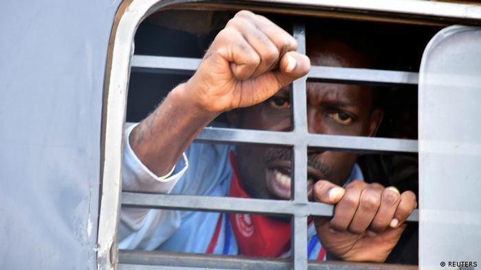 Ugandan presidential candidate Robert Kyagulanyi, also known as Bobi Wine, reacts from inside a police van, in Luuka district, eastern Uganda November 18, 2020