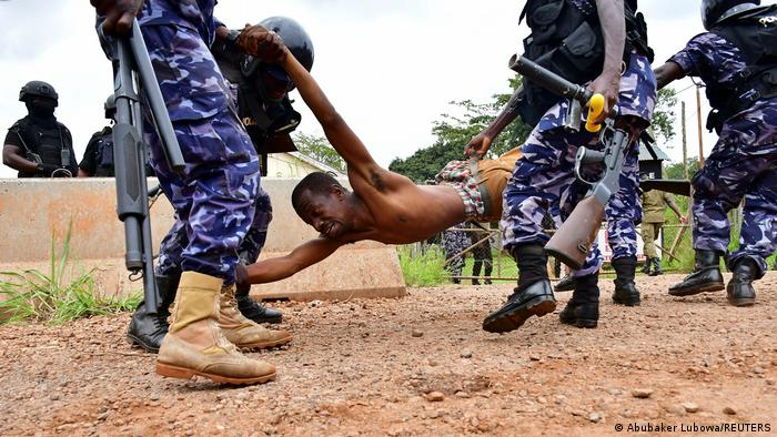 A Bobi Wine supporter being detained
