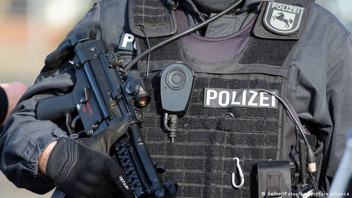 A German police officer holding a gun.