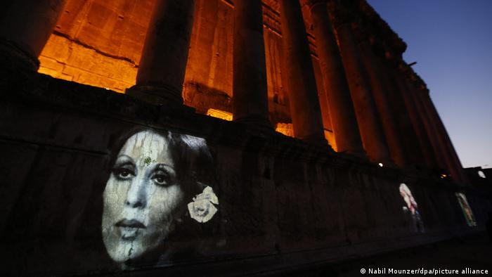 image of Fairuz on a building at night