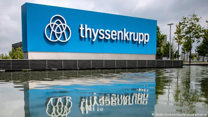 Thyssenkrupp Logo next to a lake
