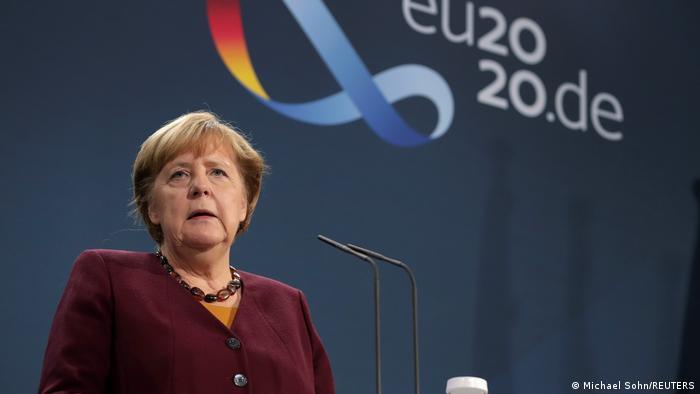 German Chancellor Angela Merkel speaks with reporters following a virtual EU summit