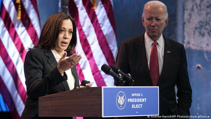 Harris speaking in Delaware at the podium, next to President-Elect Joe Biden (USA Wilmington Kamala Harris and Joe Biden)