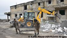 Armenian soldiers destroy and evacuate their headquarters from the town of Agdam on November 19, 2020 as the territory is due to be returned to Azerbaijan on November 20, 2020 as stipulated in a Moscow-brokered peace deal signed by Armenia and Azerbaijan on November 9. - For three decades Azerbaijan's Aghdam district has been under the control of Armenian separatists, who have also governed the neighbouring region of Nagorno-Karabakh since a post-Soviet war in the 1990s. (Photo by Karen MINASYAN / AFP) (Photo by KAREN MINASYAN/AFP via Getty Images)