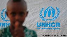 A child stands in front of a UN High Commissioner for Refugees (UNHCR) tent as Ethiopian refugees who fled fighting in Tigray province camp at the Um Rakuba camp in Sudan's eastern Gedaref province, on November 19, 2020. - Sudan -- one of the world's poorest countries, now faced with the massive influx -- has reopened the camp, 80 kilometres (50 miles) from the border. It once housed refugees who fled Ethiopia's 1983-85 famine that killed over a million people. (Photo by ASHRAF SHAZLY / AFP)