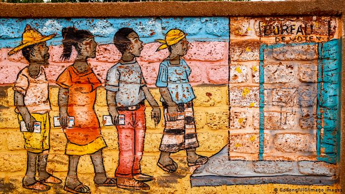 Mural showing people standing in line in front of a polling station