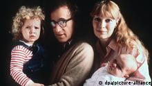 A file photograph of Woody Allen carrying Dylan, and Mia Farrow with their son Satchel