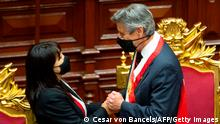 17.11.2020 *** Peruvian interim President Francisco Sagasti (R) greets the Congress head Mirtha Vasquez after recieving the presidential sash during his swearing-in ceremony in Lima on November 17, 2020. - Sagasti, a 76-year-old former World Bank official was sworn in at a special session of Congress as the South American country's new president becoming Peru's third in a rollercoaster week of political upheaval and the fourth in a four-year span. (Photo by Cesar Von BANCELS / AFP) (Photo by CESAR VON BANCELS/AFP via Getty Images)