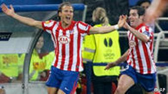 Atletico's Diego Forlan, left, celebrates scoring his side's first goal during the soccer Europa League final between Atletico Madrid and FC Fulham in the arena in Hamburg, Germany, on Wednesday, May 12, 2010.
