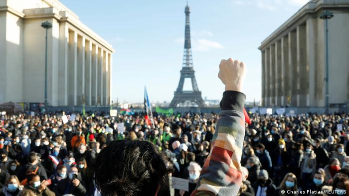 Demonstrators in Paris, Eiffel Tower in the background