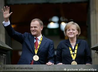 Polish Prime Minister Donald Tusk and German Chancellor Angela Merkel