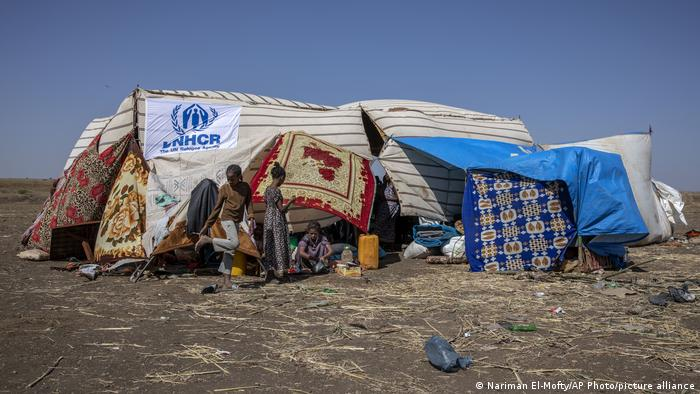 People who fled the conflict in the Ethiopia's Tigray region, gather under a make shift shelter