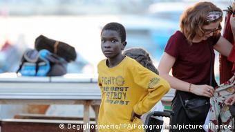 Ibrahima Gueye wearing a yellow sweatshirt, between shoots at the set of The Life Ahead