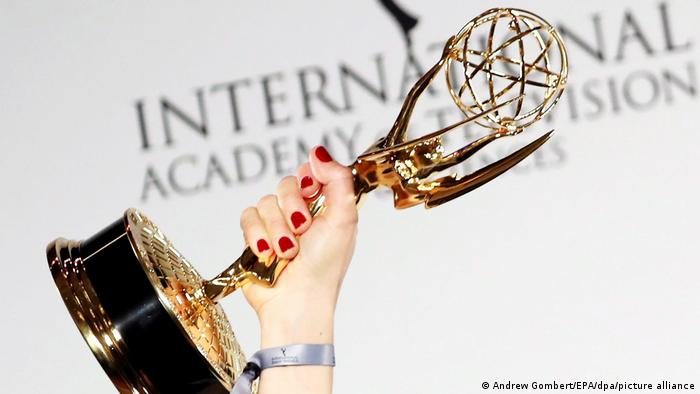 Emmy Award trophy held in the air