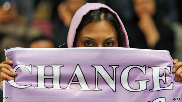 Female protester holds banner saying change