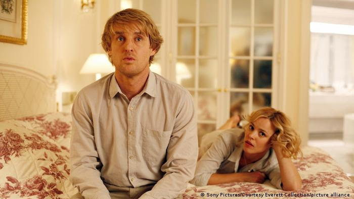 Scene from Woody Allen's Midnight in Paris - Owen Wilson is sitting on a bed, Rachel McAdams is lying behind him (Sony Pictures).
