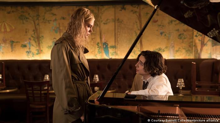 Scene from Woody Allen's A Rainy Day in New York - Elle Fanning stands next to a wing upon which Timothee Chalamet is sat (Courtesy Everett Collection).